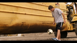 teen wih soccer ball